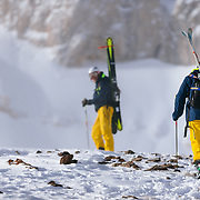 Thomas Roennau and Jim Schanzenbaker hike toward Powder 8 Face off of Cody Peak for the Powder 8 contest at Jackson Hole Mountain Resort.