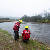 Comrie Flooding....22.11.12<br /> Firefighters at the banks of the River Ruchill in Comrie where the river burst through on Monday causing 100's of homes to be flooded. The emergency services were warning of the possibility of more flooding as a result of more heavy rain.<br /> Picture by Graeme Hart.<br /> Copyright Perthshire Picture Agency<br /> Tel: 01738 623350  Mobile: 07990 594431