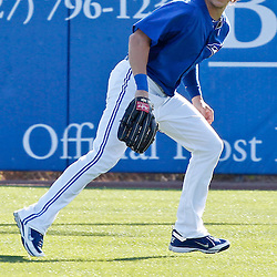 March 16, 2012; Dunedin, FL, USA; Toronto Blue Jays center fielder Colby Rasmus (28) works on drills before a spring training game against the Tampa Bay Rays at Florida Auto Exchange Stadium. Mandatory Credit: Derick E. Hingle-US PRESSWIRE