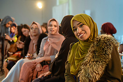© Licensed to London News Pictures. 18/02/2017. London, UK. Audience members await a catwalk show at the UK's first London Modest Fashion Week taking place this weekend at the Saatchi Gallery.  The two day event sees 40 brands from across the world come together to showcase their collections for Muslim and other religious women. Photo credit : Stephen Chung/LNP