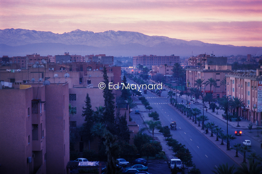 View towards the High Atlas at dawn in January, Boulevard Allal Al Fassi, Marrakech, Morocco.