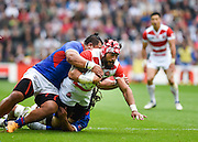 Japan back row Ryu Koliniasi Holani is tackled by Samoa prop Census Johnston during the Rugby World Cup Pool B match between Samoa and Japan at stadium:mk, Milton Keynes, England on 3 October 2015. Photo by David Charbit.