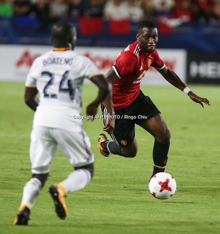 Manchester United Timothy Fosu-mensah, right, drives the ball against Los Angeles Galaxy during the second half of a national friendly soccer game at StubHub Center on July 15, 2017 in Carson, California. The Manchester United won 5-2. AFP PHOTO / Ringo Chiu