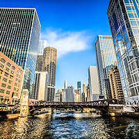 Picture of Chicago River skyline at Clark Street Bridge with Reid Murdoch Building, Marina City Towers, Hotel 71, Leo Burnett Building, and United Airlines building.