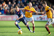 Oliver Bozanic (#7) of Heart of Midlothian shields the ball from Allan Campbell (#8) of Motherwell FC during the Ladbrokes Scottish Premiership match between Motherwell FC and Heart of Midlothian FC at Fir Park, Stadium, Motherwell, Scotland on 17 February 2019.
