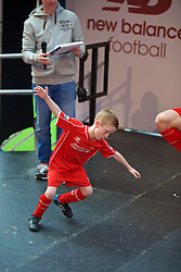 LIVERPOOL, ENGLAND - Friday, April 10, 2015: A young Liverpool supporter on stage during the launch for the New Balance 2015/16 home kit at Anfield. (Pic by David Rawcliffe/Propaganda)