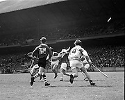 03/05/1970<br /> 05/03/1970<br /> 3 May 1970<br /> National Schools Hurling Final: Cork v Offaly at Croke Park, Dublin. <br /> Cork's K. Barry (15) runs in to help his teammates.