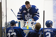 Jonathan Bernier takes a breather at the bench during a game against the Rochester Americans in Rochester, New York, USA on Friday, December 4, 2015.