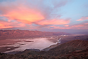 Clouds turn pastel colors as the sun rises over Death Valley National Park, Calif., on Dec. 1, 2012.