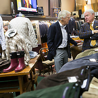 Jimmy Long, right, talks to Kenneth Williams during Long's retirement reception at MLM Clothiers in downtown Tupelo.
