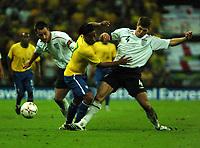 Photo: Tony Oudot.<br /> England v Brazil. International Friendly. 01/06/2007.<br /> John Terry and Steven Gerrard of England tackle Ronaldinho of Brazil