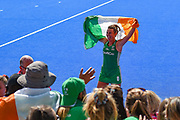 Nicola Evans of Ireland (8) celebrates with the fans holding a flag during the Vitality Hockey Women's World Cup 2018 Semi-Final match between Ireland and Spain at the Lee Valley Hockey and Tennis Centre, QE Olympic Park, United Kingdom on 4 August 2018. Picture by Martin Cole.