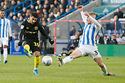 A shot by Saïd Benrahma of Brentford is blocked by Lewis O'Brien of Huddersfield Town  during the EFL Sky Bet Championship match between Huddersfield Town and Brentford at the John Smiths Stadium, Huddersfield, England on 18 January 2020.