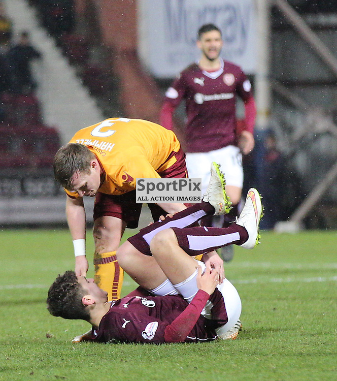 Hearts v Motherwell Scottish Premiership 16 January 2016; Steven Hammell (Motherwell, 3) picks up Dario Zanatta (Hearts, 44) after a hard challenge on the Hearts youngster which earned him a booking during the Heart of Midlothian v Motherwell Scottish Premiership match played at Tynecastle Stadium, Edinburgh; <br /> <br /> &copy; Chris McCluskie | SportPix.org.uk