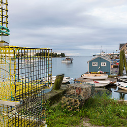 Lobster traps and skiffs at the Vinalhaven Fishermen's Co-op in Vinalhaven, Maine.
