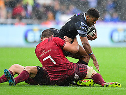 Ospreys' Keelan Giles is tackled by Munster's Tommy O'Donnell - Mandatory by-line: Craig Thomas/JMP - 16/09/2017 - RUGBY - Liberty Stadium - Swansea, Wales - Ospreys Rugby v Munster Rugby - Guinness Pro 14
