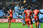 Coventry City defender Jordan Willis (4) heads at goal 1-0 during the EFL Sky Bet League 2 match between Coventry City and Wycombe Wanderers at the Ricoh Arena, Coventry, England on 22 December 2017. Photo by Alan Franklin.