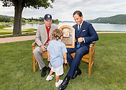 COOPERSTOWN, NY - JULY 23, 2016: Newly inducted Hall of Famer Mike Piazza shows his son Marco Vincenzo Piazza his Hall of Fame plaque, as his father Vince Piazza looks on, during a photo shoot on the back lawn of the Otesaga Resort Hotel on July 24, 2016 in Cooperstown, New York. (Photo by Jean Fruth)
