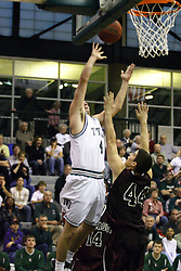 16 December 2006: Mike Harrigan takes a short jump shot over the arms of Jake Pancratz. The University of Chicago Maroons upset  the Illinois Wesleyan Titans 64 - 60 at the Shirk Center in Bloomington Illinois.<br />