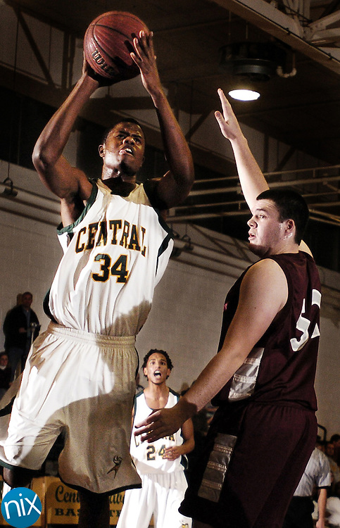 Central Cabarrus' Drew Glover goes up for a shot over Robinson's R.J. Mattes Thursday night at Central Cabarrus High School.