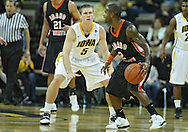 December 04 2010: Iowa Hawkeyes guard Matt Gatens (5) defends against Idaho State Bengals guard Broderick Gilchrest (2) during the first half of their NCAA basketball game at Carver-Hawkeye Arena in Iowa City, Iowa on December 4, 2010. Iowa won 70-53.