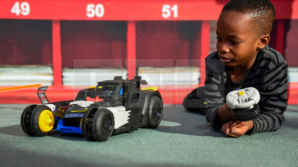 """© Licensed to London News Pictures. 13/11/2019. LONDON, UK. Mofe (aged 6) plays with an Imaginext DC Super Friends Transforming Batmobile by Mattel at the preview of """"DreamToys"""", the official toys and games Christmas Preview, held at St Mary's Church in Marylebone.  Recognised as the countdown to Christmas, the Toy Retailer's Association, an independent panel of leading UK toy retailers, have selected the definitive and most authoritative list of which toys will be the hottest property this Christmas.  Photo credit: Stephen Chung/LNP"""