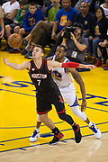 Golden State Warriors forward Andre Iguodala (9) pops the ball out of the hands of Houston Rockets forward Sam Dekker (7) at Oracle Arena in Oakland, Calif., on March 31, 2017. (Stan Olszewski/Special to S.F. Examiner)