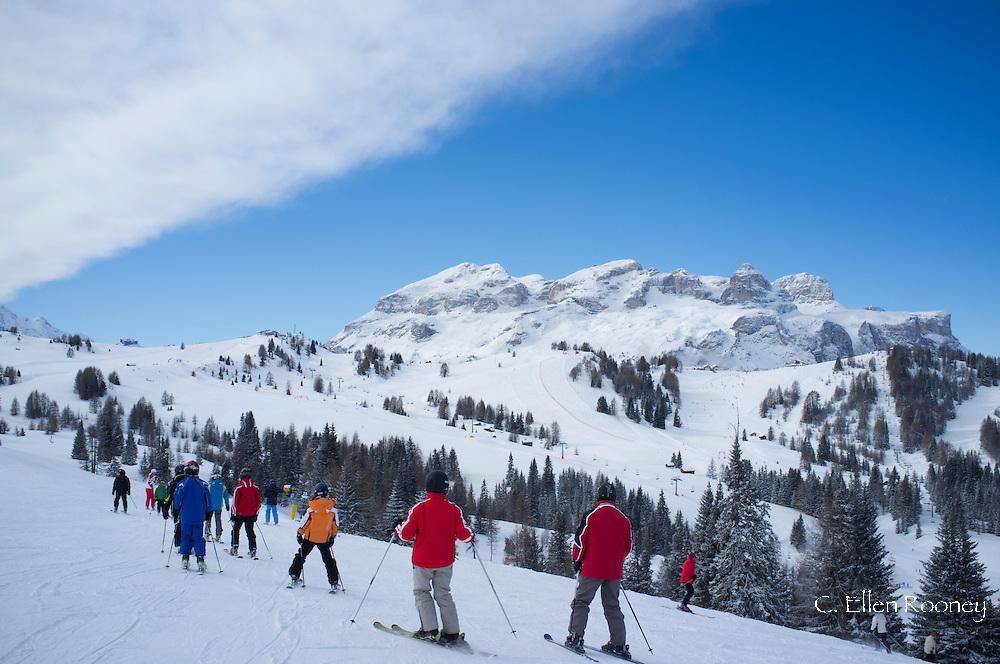 A group of skiers at the Alta Badia ski resort near Corvara, The Dolomites, South Tyrol, Italy