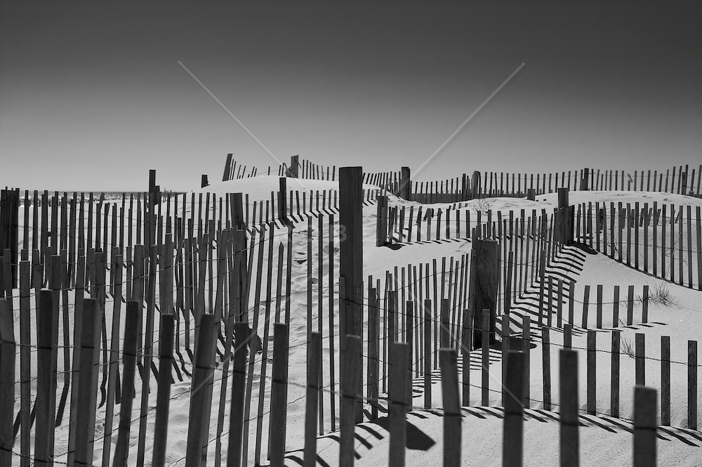 wooden fences in the sand in Westhampton, NY beach
