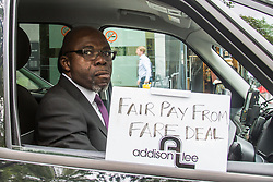 "Mayfair, London, May 24th 2016. Drivers from minicab operator Addison Lee bring traffic to a standstill in Berkely Square, outside of the offices of owner Carlyle Group, in protest against new ""unfair"" pay rates as the company battles to compete with cut-price Uber, with some drivers claiming they are earning as little as £4.99 per hour. PICTURED: A driver demands fair pay from the fares that he earns Addison Lee."