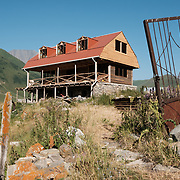 A guesthouse under construction in the village of Abano in the Truso Valley, near the border with occupied territory of South Ossetia in the Mtskheta-Mtianeti region of Georgia.  The entire valley is all but abandoned, and for most of the year is home only to a lone homesteader, a monk, and four nuns and a priest who live in a small abbey. The building is a project of the abbey, and is intended to provide a place for visitors to stay.