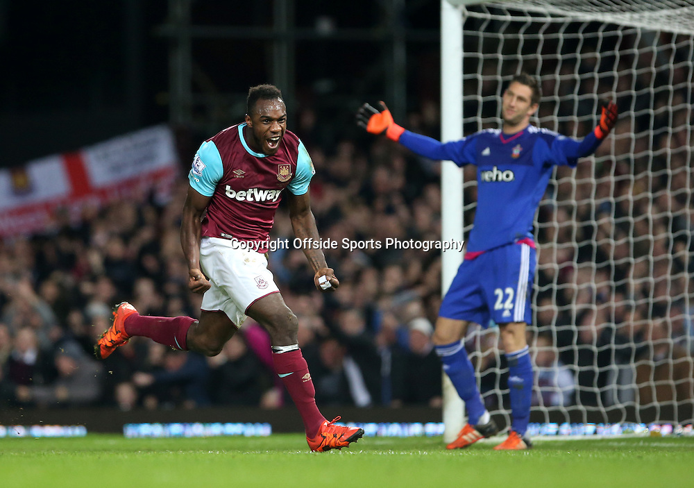 28 December 2015 - Premier League - West Ham United v Southampton<br /> Michail Antonio celebrates scoring for West Ham whilst Southampton goalkeeper Maarten Stekelenburg holds up his hands in disbelief behind<br /> Photo: Charlotte Wilson / Offside