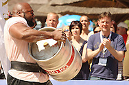 Journalist Alistair Ross (The Sun, UK) in the background cheers on fellow countryman Mark Felix during the keg race at the World's Strongest Man competition held in Sun City, South Africa.
