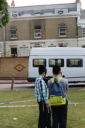 © Licensed to London News Pictures. 05/07/2017. London, UK. Children look at fire damage to a Jewish faith school in Belz Terrace, Hackney, after it went on fire overnight. According to reports,100 firefighters were deployed to tackle a blaze after the alarm was raised shortly before midnight on Tuesday, 4 July 2017.  Photo credit: Dinendra Haria/LNP