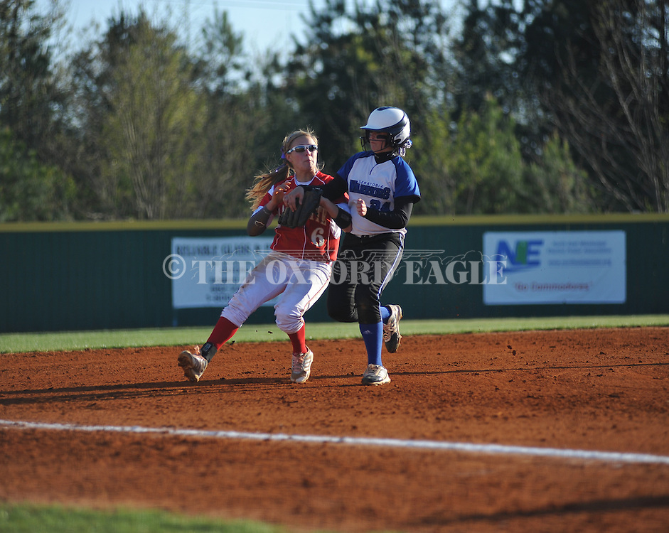 Senatobia's Chelsea Davis (24) is safe at third and goes on to score as the the ball gets past Lafayette High shortstop Emily Robinson (6) after they collided on the play, in Oxford, Miss. on Tuesday, April 15, 2014.
