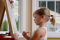 Girl drawing at easel