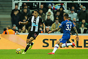 Isaac Hayden (#14) of Newcastle United on the ball under pressure from Emerson Palmieri (#33) of Chelsea during the Premier League match between Newcastle United and Chelsea at St. James's Park, Newcastle, England on 18 January 2020.