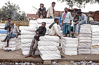 Group of men resting in the streets of Old Delhi, India.