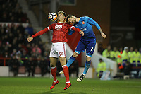 Tyler Walker beats Arsenal's Matthieu Debuchy to the ball  during The Emirates FA Cup Third Round match between Nottingham Forest and Arsenal at City Ground on January 7, 2018 in Nottingham, England.