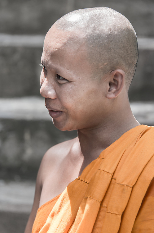A Buddhist monk engaged in conversation at Peung Pagoda in Cambodia.