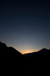 The sun sets behind Kings Canyon and the Kings River, near Kings Canyon National Park, California, USA.