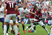 Bournemouth defender Steve Cook (3) in the thick of the action during the Premier League match between West Ham United and Bournemouth at the London Stadium, London, England on 18 August 2018.