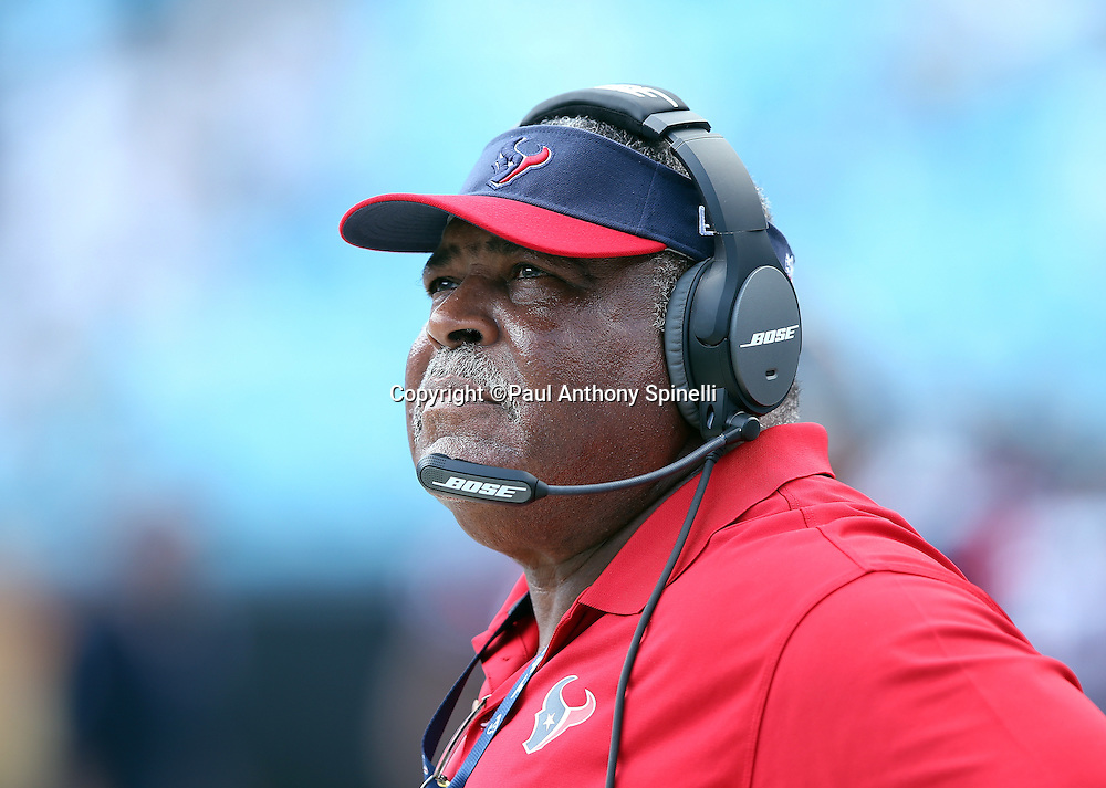 Houston Texans defensive coordinator Romeo Crennel looks on from the sideline during the 2015 NFL week 2 regular season football game against the Carolina Panthers on Sunday, Sept. 20, 2015 in Charlotte, N.C. The Panthers won the game 24-17. (©Paul Anthony Spinelli)
