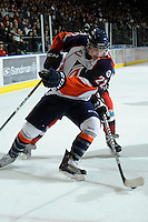KELOWNA, CANADA, OCTOBER 29: JT Barnett #22 of the Kamloops Blazers gets checked as the Kamloops Blazers visit the Kelowna Rockets  on October 29, 2011 at Prospera Place in Kelowna, British Columbia, Canada (Photo by Marissa Baecker/Shoot the Breeze) *** Local Caption *** JT Barnett;