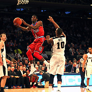 Rysheed Jordan, St John's, wearing twenty-three, drives to the basket during the Providence Vs St. John's Red Storm basketball game during the Big East Conference Tournament at Madison Square Garden, New York, USA. 12th March 2014. Photo Tim Clayton