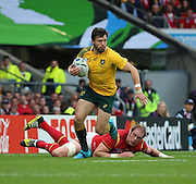 Australia's wing Adam Ashley-Cooper breaking a tackle and running free during the Rugby World CupPool A match between Australia and Wales at Twickenham, Richmond, United Kingdom on 10 October 2015. Photo by Matthew Redman.