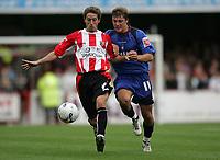 Photo: Lee Earle.<br /> Brentford v Bradford City. Coca Cola League 1. 02/09/2006. Brentford's Paul Brooker (L) battles with Lee Holmes.