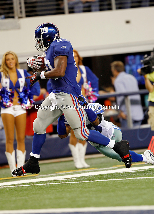 New York Giants running back Brandon Jacobs (27) runs for a 30 yard touchdown that gives the Giants a 38-20 lead despite a diving tackle attempt by Dallas Cowboys safety Gerald Sensabaugh (43) during the NFL week 7 football game against the Dallas Cowboys on Monday, October 25, 2010 in Arlington, Texas. The Giants won the game 41-35. (©Paul Anthony Spinelli)