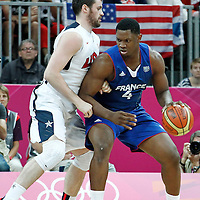 29 July 2012: Kevin Seraphin of France posts up USA Kevin Love during the 98-71 Team USA victory over Team France, during the men's basketball preliminary, at the Basketball Arena, in London, Great Britain.