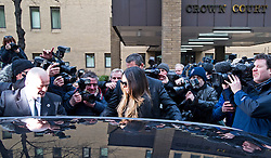 © London News Pictures. 18/02/2013 . London, UK.  Tamara Ecclestone (centre) being ushered in to a Rolls Royce car by security surrounded by media as she leaves Southwark Crown Court on February 18, 2013 where two men are standing trial for allegedly blackmailing Tamara Ecclestone for for £200,000. Photo credit : Ben Cawthra/LNP